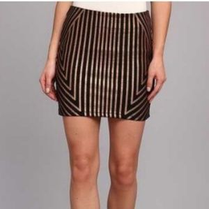 MINKPINK black w/gold stripes mini skirt Sz S NWOT